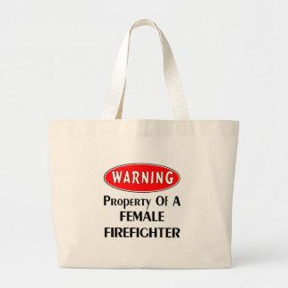 Het waarschuwen: Bezit van een Vrouwelijke Grote Draagtas