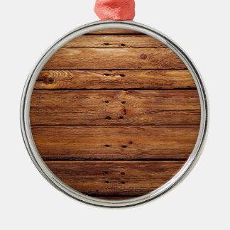 houten vloer zilverkleurig rond ornament