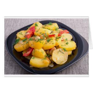 Hutspot van aardappels met ui, groene paprika en wenskaart