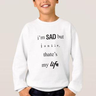 ik ben droevig maar ik glimlach. dat is mijn life2 trui
