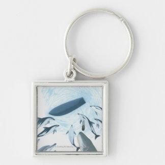 Illustratie van dolfijnen die omhoog een boot sleutelhanger