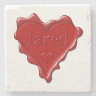 Jared. De rode verbinding van de hartwas met naam Stenen Onderzetter