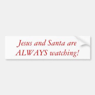 Jesus en Kerstman die bumper op sticker letten