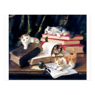 Katjes die op een bureau spelen briefkaart