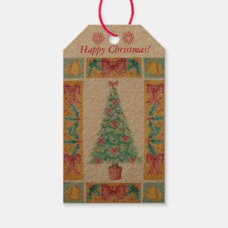 Kerstboom met de klokkenart. van decoratie rood cadeaulabel