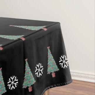 Kerstboom met de klokkenart. van decoratie rood tafelkleed