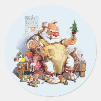 Kerstman die de Stickers van het Speelgoed maken