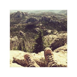 Laarzen aan Zwarte Heuvels Canvas Afdrukken