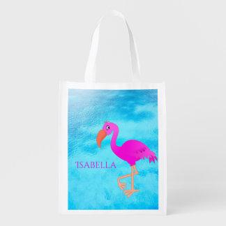Leuke roze en girly tropische flamingo op blauw herbruikbare boodschappentas