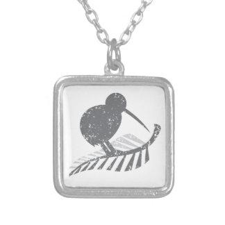 leuke zilveren verontruste kiwivogel en zilveren zilver vergulden ketting