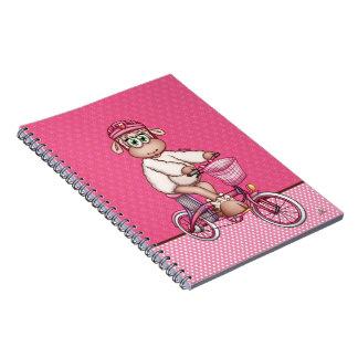 Lilly de Schapen die een elektrische fiets Notitieboek