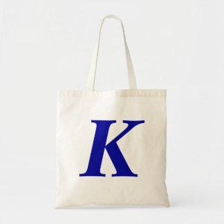 Monogram K in de blauwe zak van het douane Budget Draagtas
