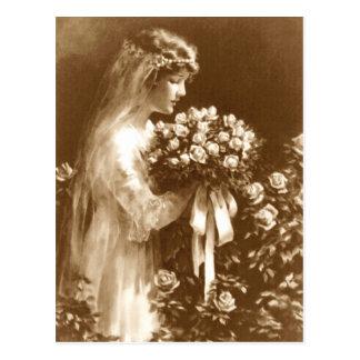Mooie bruid met een roze boeket briefkaart