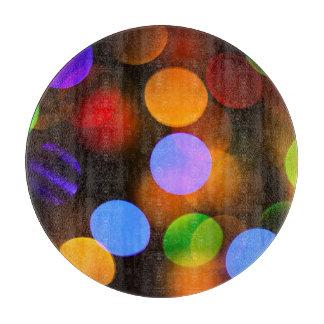 Multicolored lichten van Kerstmis Snijplank