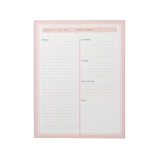 Om lijst dagelijks te doen bloos notitieblok