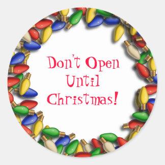 Open niet tot de sticker van Kerstmis