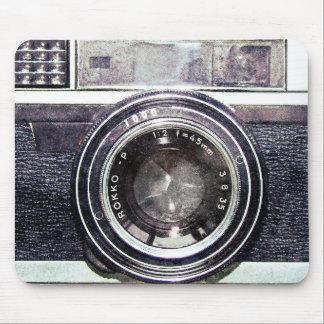 Oude zwarte camera muismat