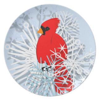 Rode kardinaal in sneeuwsterren bord