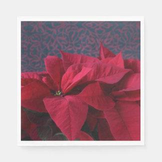 Rode poinsettia op decoratieve achtergrond papieren servet