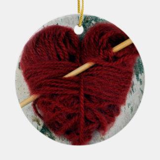 Rood wolhart op het ornament van de