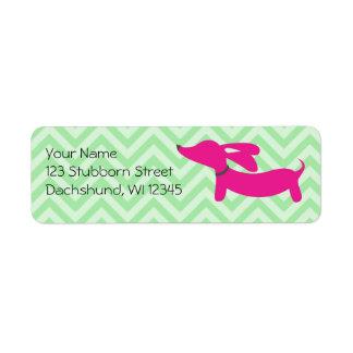 Roze tekkel op groene chevrons etiket