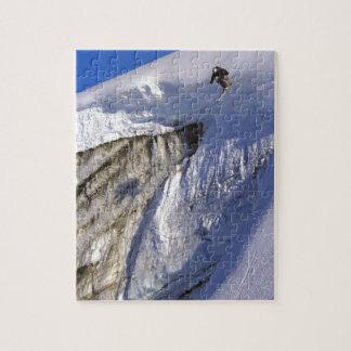 Skiër die van de muur van de Gletsjer in Groenland Puzzel