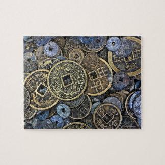 Sluit omhoog van Vietnamese muntstukken Legpuzzel
