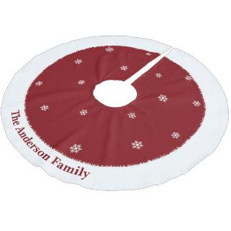 Sneeuwvlokken op de rode rok achtergrond van de kerstboom rok