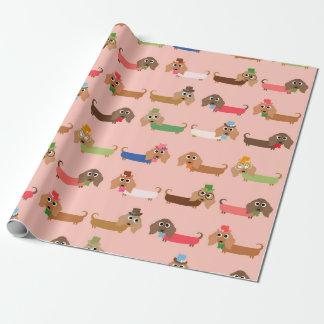 Tekkels op Roze Inpakpapier