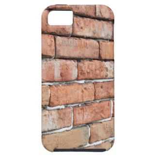 Uitzicht van een oude bakstenen muur met een tough iPhone 5 hoesje