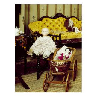 Vintage ruimte met poppen en rieten kinderwagen briefkaart