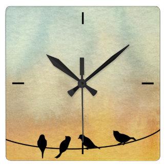Vogels op een draad vierkante klok