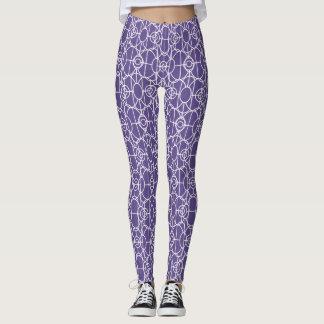 Wit art decopatroon op ultraviolet leggings
