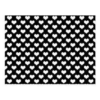 Wit hartenpatroon op een zwarte achtergrond briefkaart