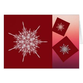 Witte sneeuwvlokken op rode vierkanten kaart
