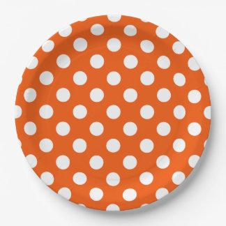 Witte stippen op sinaasappel papieren bordje
