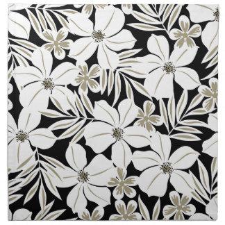 Witte tropische bloemen op zwarte katoenen servet