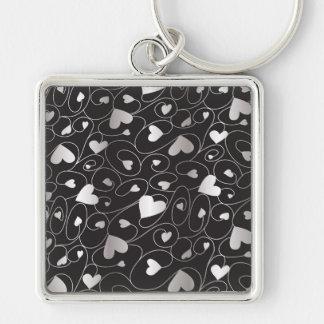 Zilveren krullende harten zilverkleurige vierkante sleutelhanger