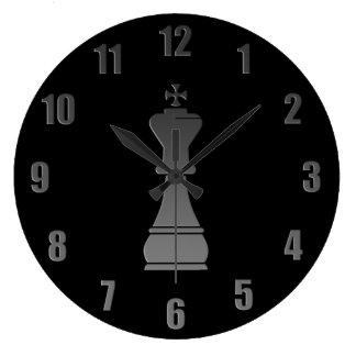 Zwart koningsschaakstuk grote klok