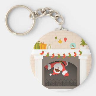 zwarte die santa in open haard wordt geplakt basic ronde button sleutelhanger