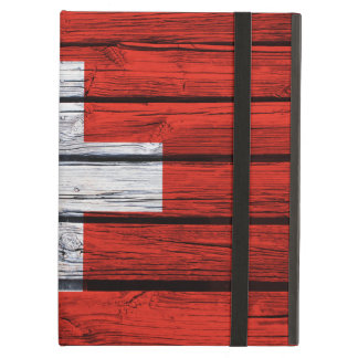 Zwitserse die Vlag op Rustiek Hout wordt geschilde iPad Air Hoesje